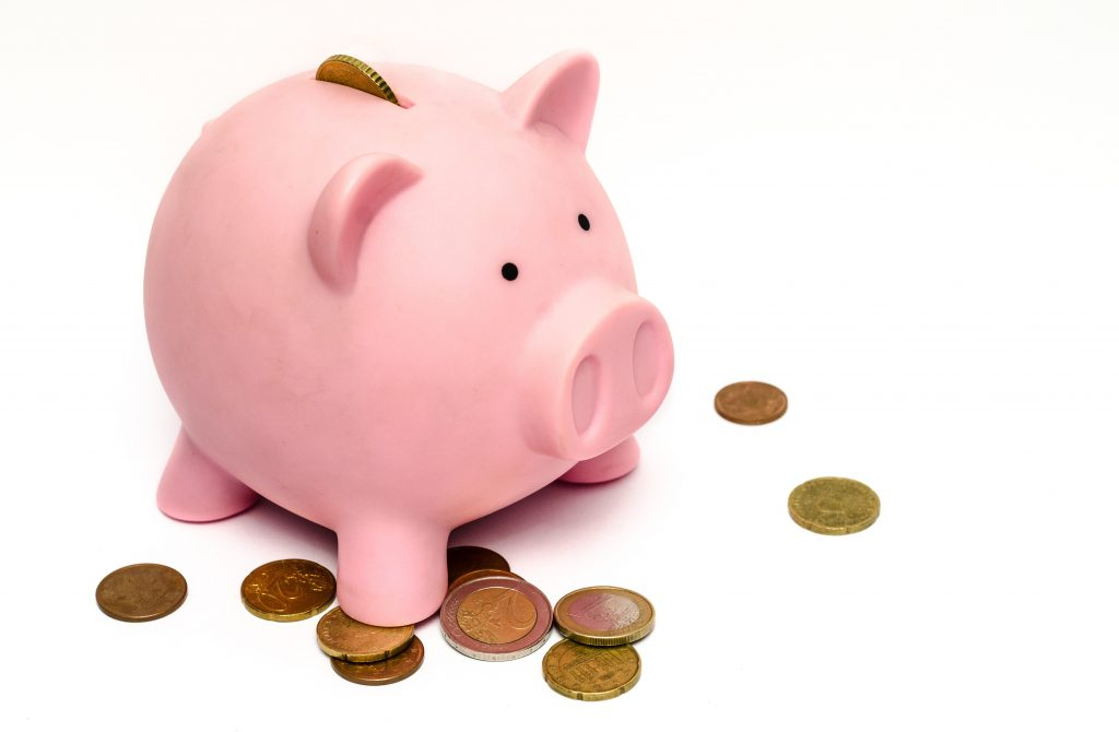 Money pig, showing investment (money) going into it.